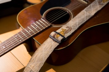 Melanie Brown's guitar and salmon skin strap. She plays as M & M, 7 p.m. Saturday on the main stage. (Photo by Annie Bartholmew/KTOO)