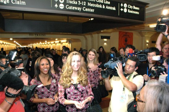 2012 Rose Queen Drew Helen Washington, left, Princess Morgan Eliza Devaud and Princess Kimberly Victoria Ostiller greet transit patrons at Union Station.