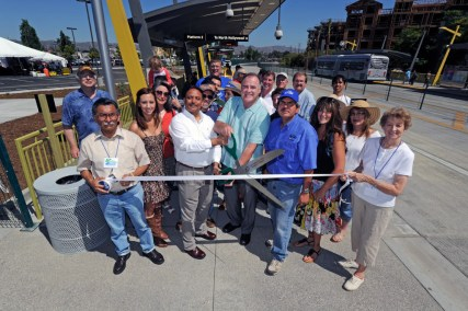 United Chambers of Commerce chairman John Parker and Hitesh Patel, who directed the construction of the Orange Line Extension, lead the welcoming ceremony at Canoga Station.