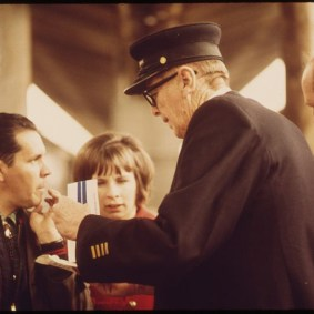 An Amtrak conductor helps passengers at Union Station in 1974. Photo: U.S. EPA.