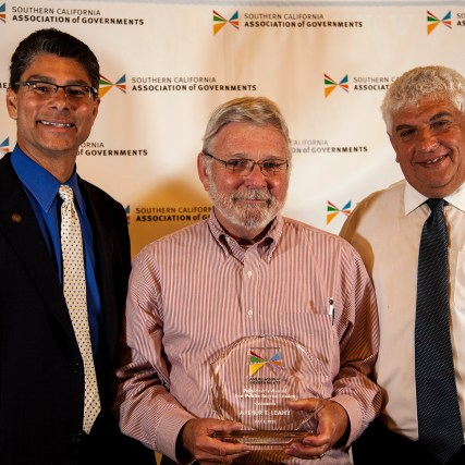 Art Leahy (center), Metro CEO, receives the Public Sector Leader of the Year award from SCAG President Glen Becerra (left) and Executive Director Hasan Ikhrata (right).