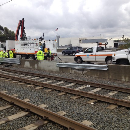 Caltrans work crews out repairing damage from the accident on 210 freeway this morning. Photo: Metro