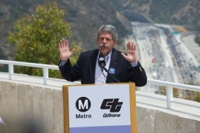 Supervisor and then-Metro Board Member Zev Yaroslavsky at a May event at the Getty to celebrate the opening of the northbound HOV lane on the 405 freeway through the Sepulveda Pass. The lane is seen in the background. Photo: Gary Leonard for Metro.
