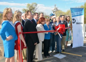 Local officials celebrate the official completion of the McBean Bridge Widening and Bike Path Project.