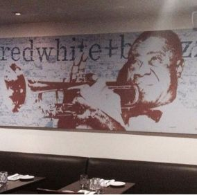 Louis Armstrong lives at Redwhite+bluezz restaurant, which hosts live jazz performances seven nights a week!