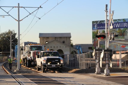 Clearance testing next to the old Santa Fe depot in Monrovia; the new Gold Line station is west of the old depot. Photo: Gold Line Foothill Extension Construction Authority.