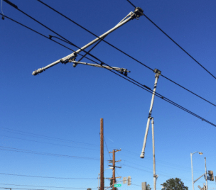 Broken overhead power supply support structures that Metro crews are currently repairing near Compton Station.