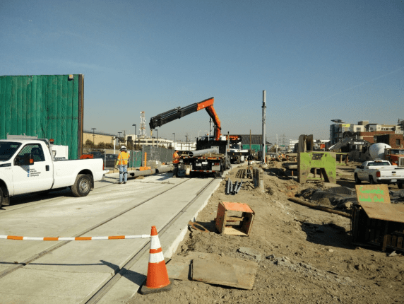 Installation of overhead catenary wire system pole on the shoofly track.