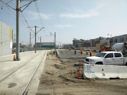 Installation of K rail traffic barrier along 1st Street.