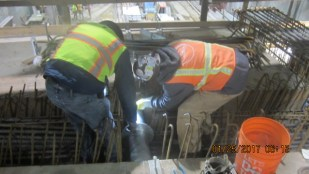 Installation of a fire line at Expo/Crenshaw Station.