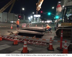 C1045 170310 955pm STS, SE Wilshire-La Brea, removing deck panel for DWP chipping work, FN