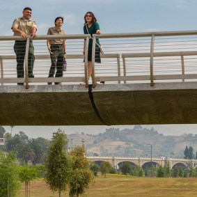 Enjoying the view from the Roundhouse Bridge with park rangers Luis Rincon and Kya-Marina Le.