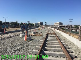 Rail placement continues along the alignment.