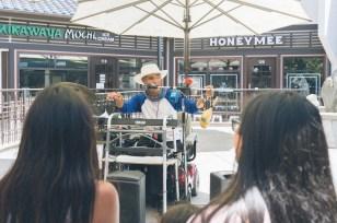 Local legend one-man band Arthur Nakane performing at Japanese Village Plaza.