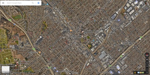 A satellite view of development around the San Fernando Road south of the Sylmar/San Fernando Metrolink Station, which is at top left. Credit: Google Maps.
