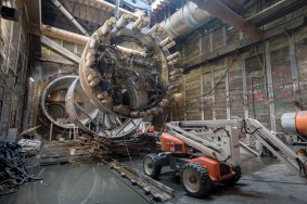 Extracting one of the tunnel boring machine shield segments from the 4th/Flower St intersection. Photo by Ken Karagozian.