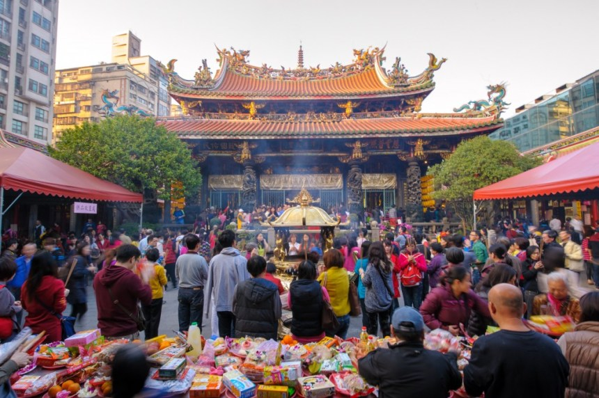 Taipei, Taiwan - February 1, 2014: traditional Chinese temple named Mengjia Longshan Temple in Wanhua District, Taipei, Taiwan, served as a place of worship and a gathering place for the Chinese settlers.