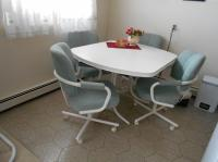 Kitchen table and four swivel chairs (table extension ...