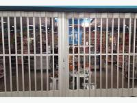 Glass and Aluminum Accordion Store Front Security Door