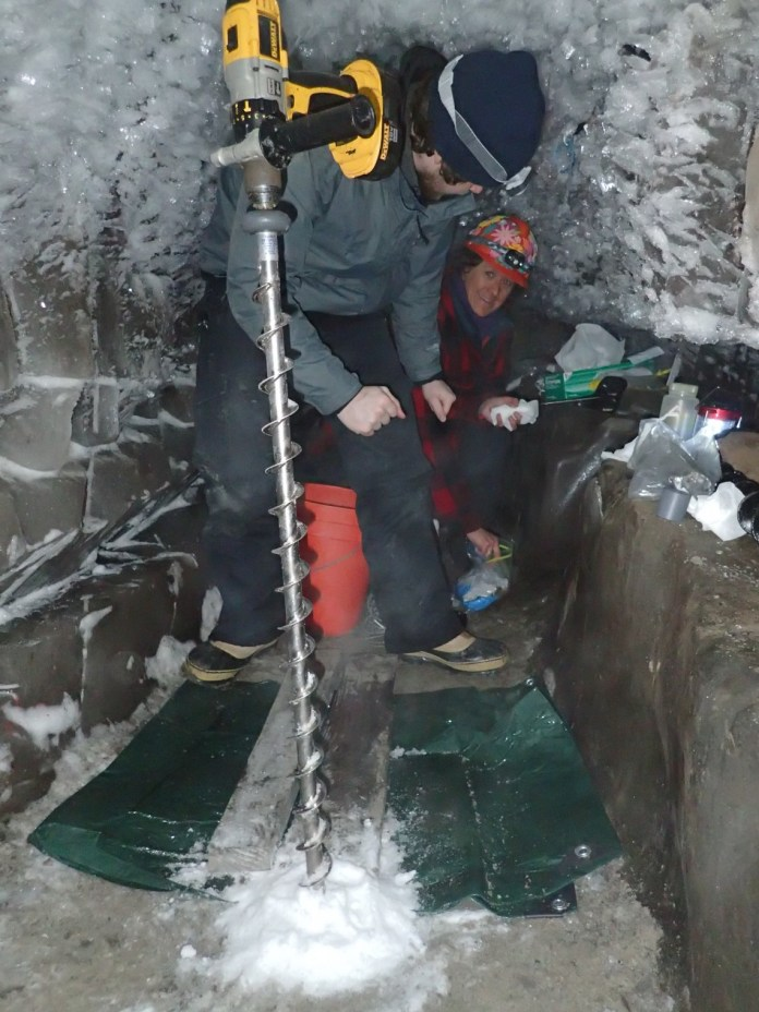 people in the ice cave