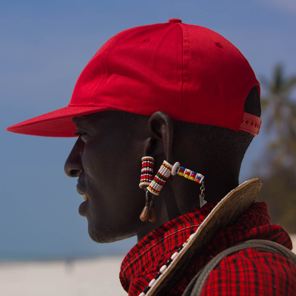 a picture of a maasai man with a hat on