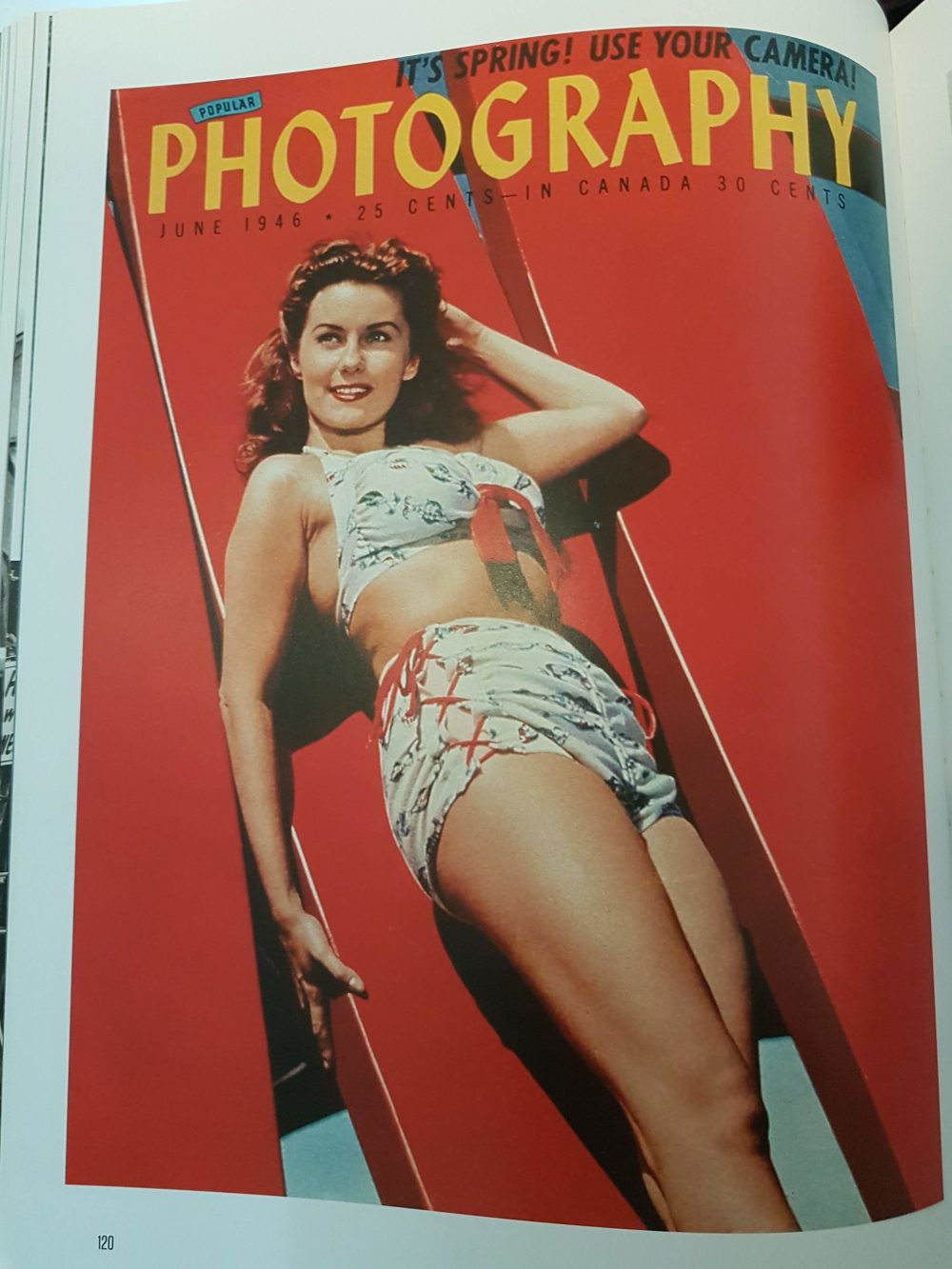 a photo of a lady in a old style bikini on a surf board