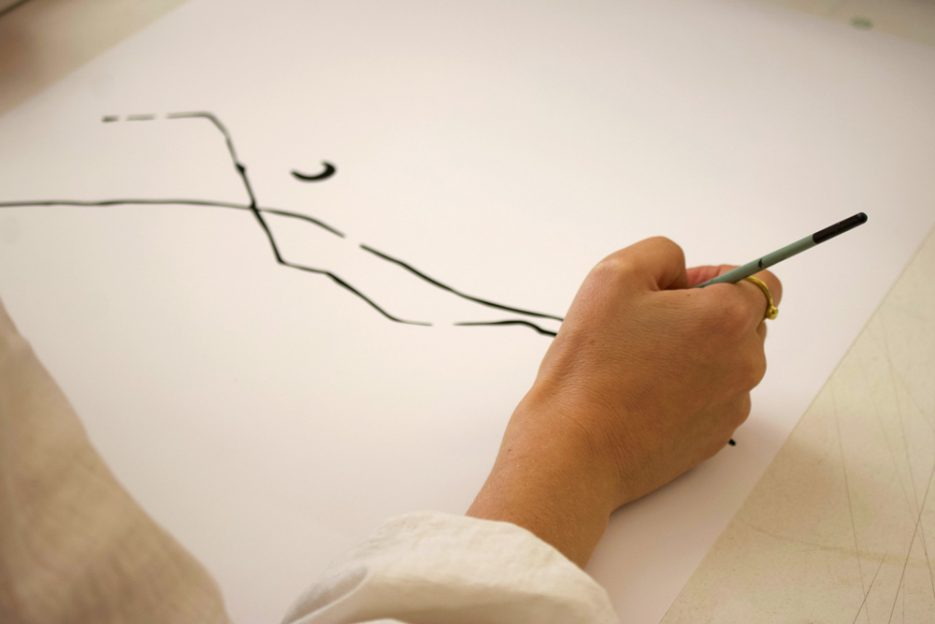Amor Coetzee, Dayfeels founder, at work creating illustrations. Image by Amber Rose Cowie.