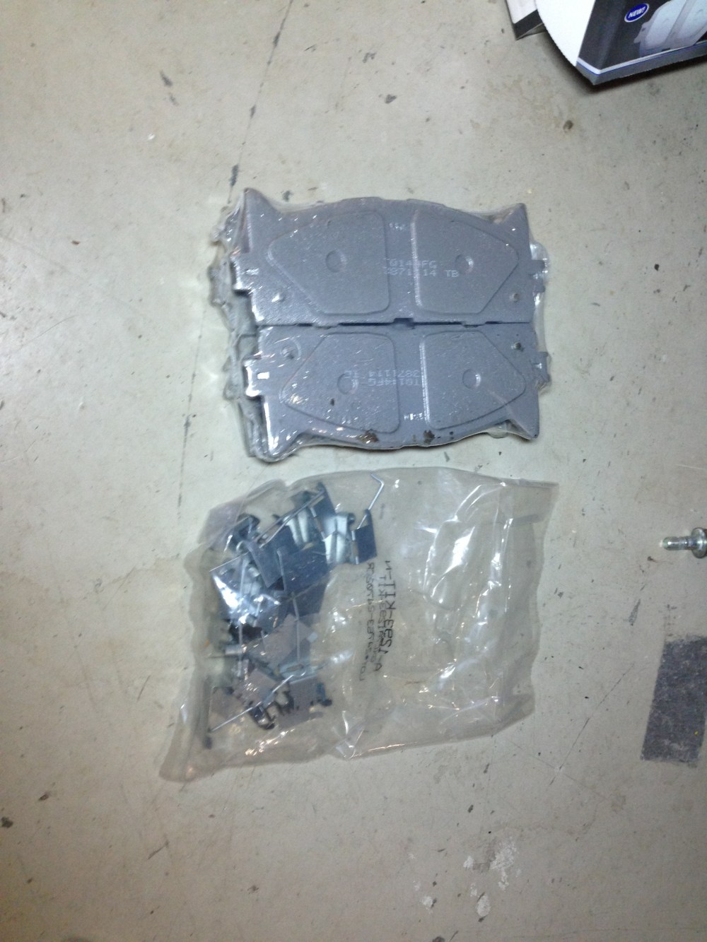 medium resolution of picture of the front brake pads with the hardware it comes with front brake pads