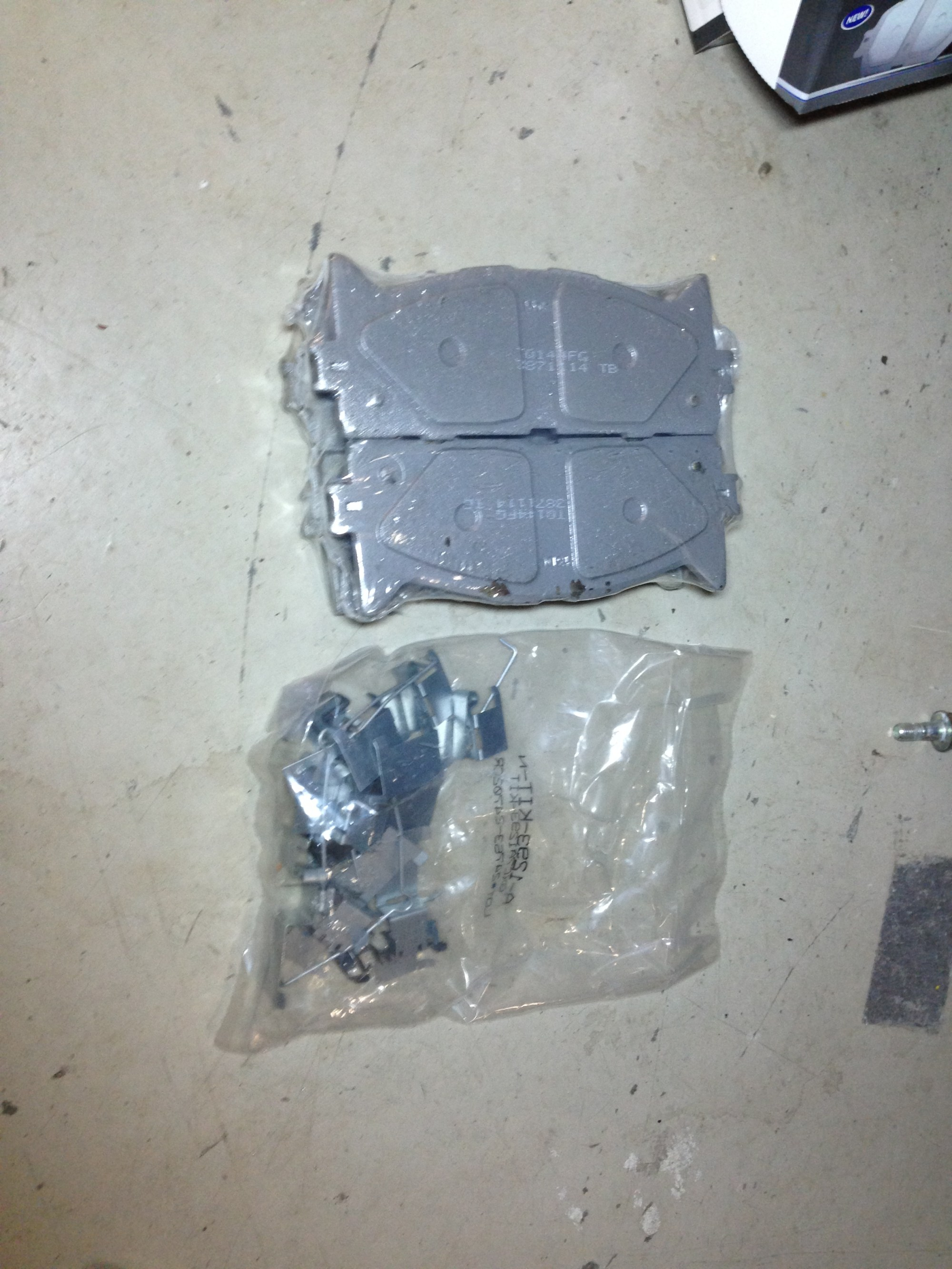 hight resolution of picture of the front brake pads with the hardware it comes with front brake pads