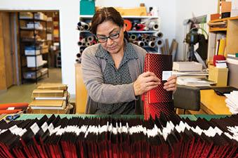 Maria Solorio, manager of the Paper Hammer book bindery.