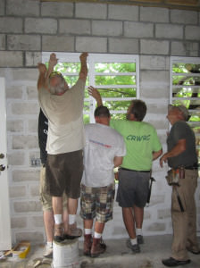 Volunteers putting up an addition to missionary Ben Hopp's house in Haiti