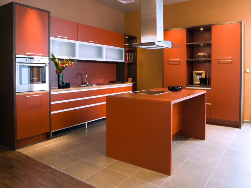 Redish orange luxury kitchen design with simple island and tile flooring
