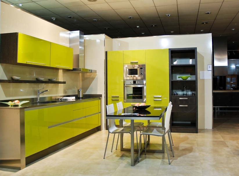 Green, white and black kitchen design with eat-in table
