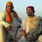 Pandit Vishnu Shastri and Shyamdas engaged in satsang by the banks of Shri Yamunaji, ca. 2000