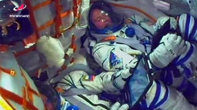 Astronautas durante el regreso de emergencia
