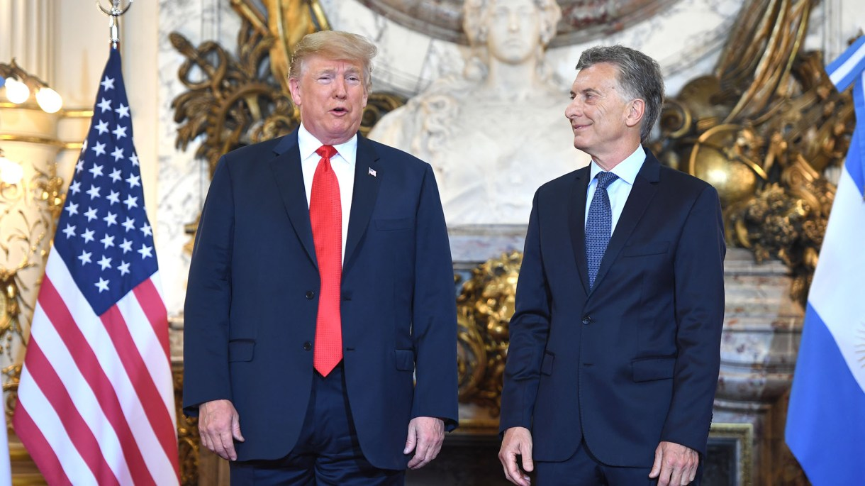 US President Donald Trump (L) is welcomed by Argentina's President Mauricio Macri at Casa Rosada presidential house in Buenos Aires, on November 30, 2018, to hold a meeting in the sidelines of the G20 Leaders' Summit. – G20 powers open two days of summit talks on Friday after a stormy buildup dominated by tensions with Russia and US President Donald Trump's combative stance on trade and climate fears. (Photo by SAUL LOEB / AFP)