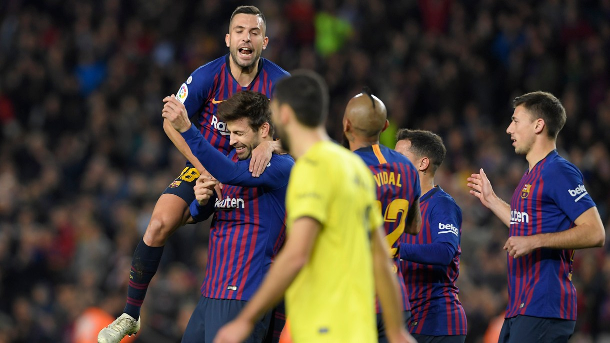 Barcelona's Spanish defender Gerard Pique (2L) celebrates with Barcelona's Spanish defender Jordi Alba after scoring during the Spanish league football match FC Barcelona against Villarreal CF at the Camp Nou stadium in Barcelona on December 2, 2018. (Photo by LLUIS GENE / AFP)