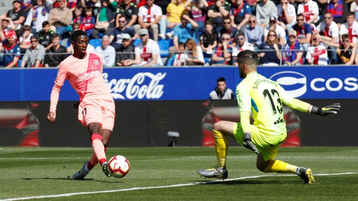 Soccer Football – La Liga Santander – SD Huesca v FC Barcelona – Estadio El Alcoraz, Huesca, Spain – April 13, 2019  Barcelona's Ousmane Dembele in action with Huesca's Roberto Santamaria        REUTERS/Albert Gea