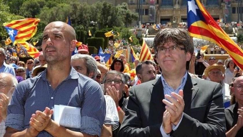 Guardiola, ex entrenador del Barcelona y Carles Puigdemont, Presidente de la Generalidad de Cataluña entre 2016-2017, en un acto en favor del referéndum en 2017