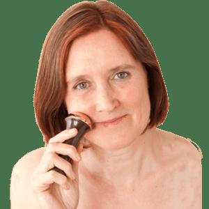 Woman using a Kansa Wand, Ayurvedic Massage tools to know.