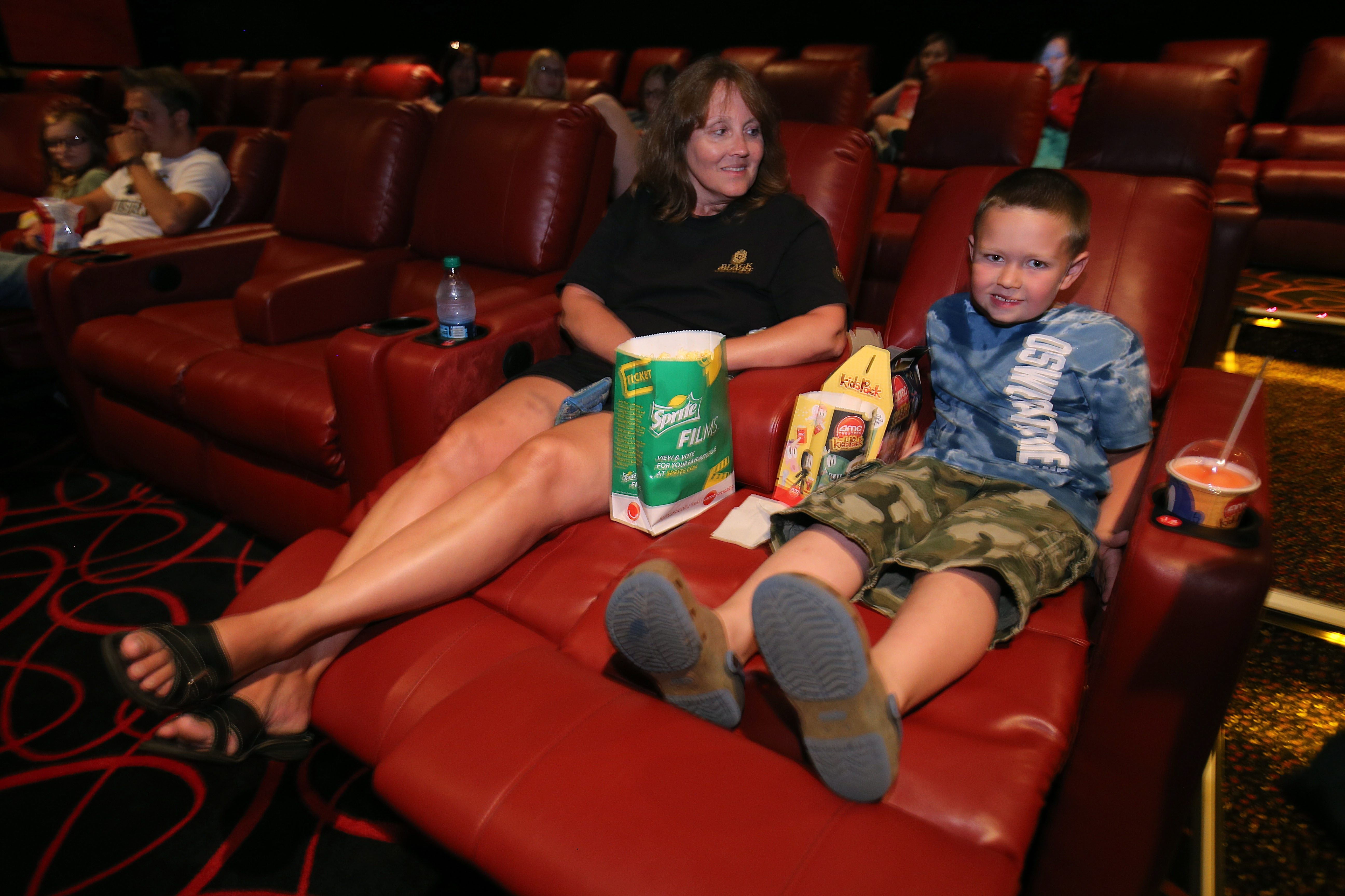 Reclining Chair Movie Theater Amc S Comfort Revolution Brings Red Leather Recliners To Compete