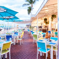 Key West Chairs High Chair Portable Margaritaville Resort Marina Photo Gallery Tables With Umbrellas And In The Open Air