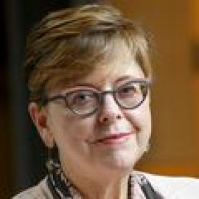 portrait of Nancy L. Haigwood, Ph.D., a mature adult in glasses