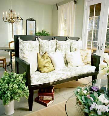 turn old chairs, an old headboard, an old table and old cushions into a chic country inspired seating area