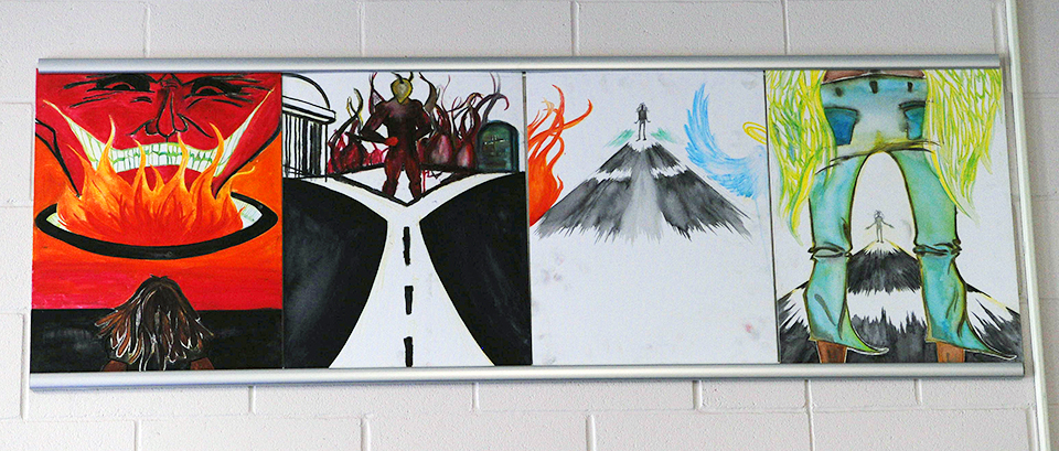 photo of paintings from jail school