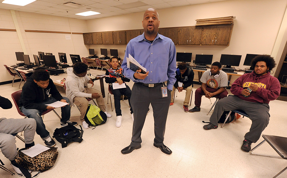 photo of michael walker standing in front of a group of students