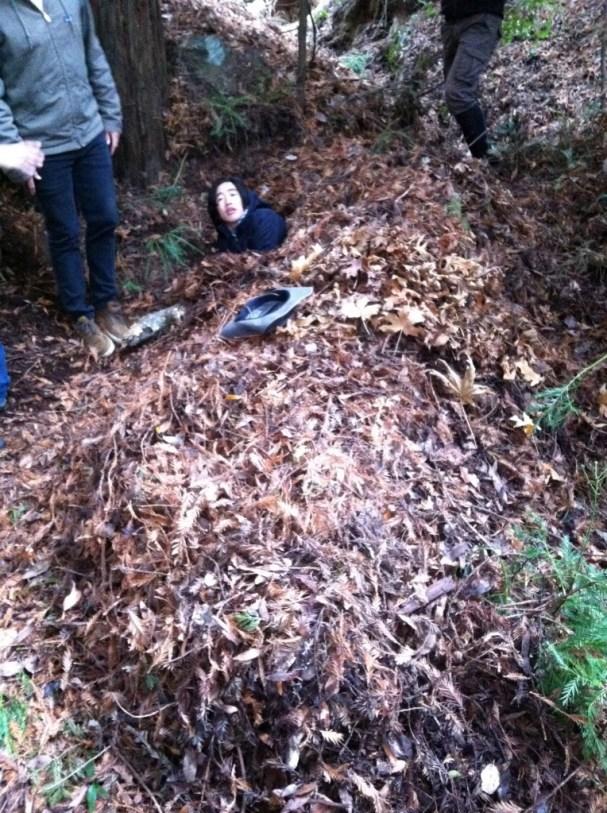 Stan in a debris hut