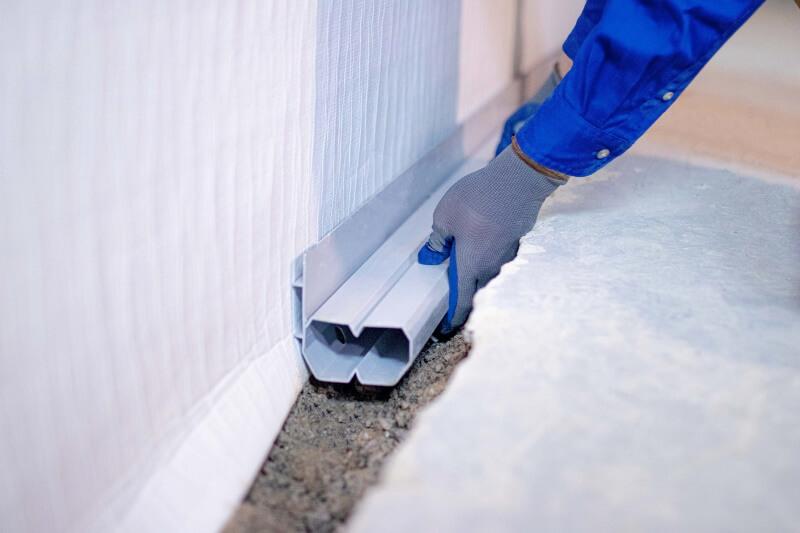 exterior drain tile vs interior drain