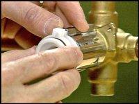 Adjusting the Posi-Temp temperature control shower valves.