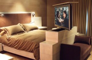 Keep A TV Under Wraps In A Master Bedroom By Placing It On